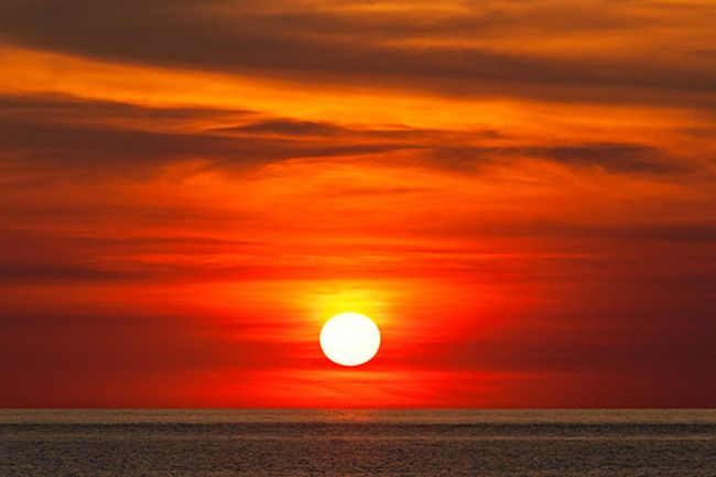 indian ocean and red sun of sunset